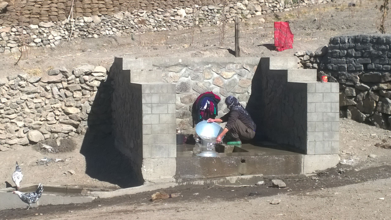 A woman washes her clothes in clean water