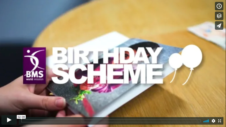 image of hand opening birthday card with words 'birthday scheme' and BMS logo