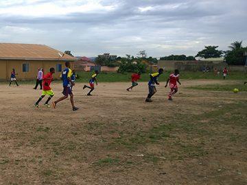Boys of the Blessed Boys Football Club in Guinea play football.