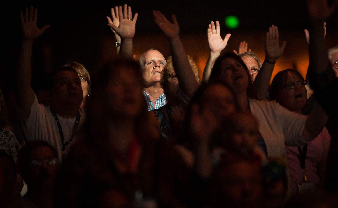 People worship during a service