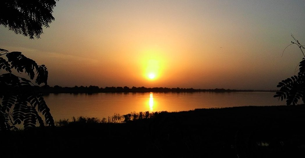 The sun sets over the River Chari in Chad.