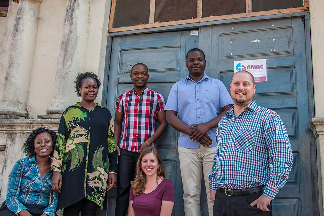 Members of the BMS-supported legal team in Mozambique stand in front of their office entrance