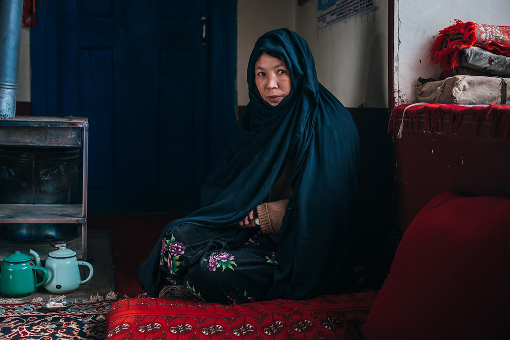 Andisha sits in her house in her village in Afghanistan's mountains