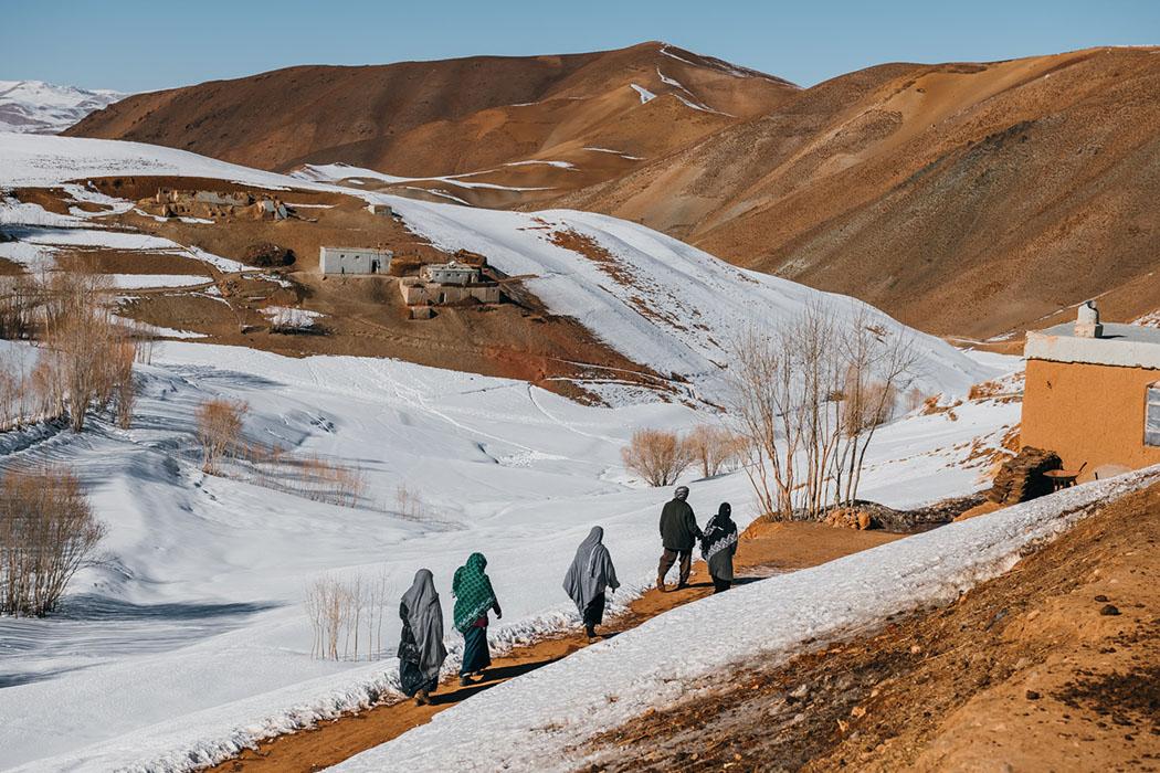 Course facilitators walk to remote villages in the snow