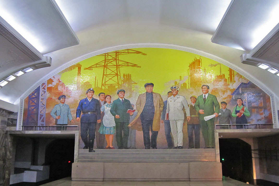 A mural of Kim Jong-un and workers in Pyongyang Metro