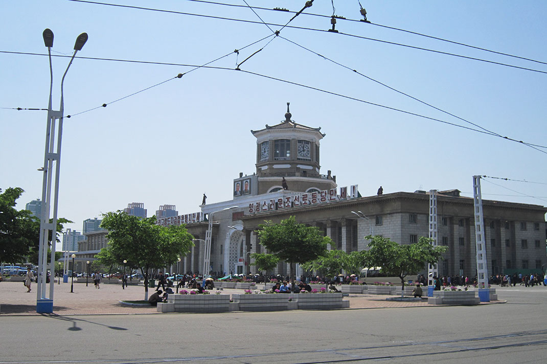 The outside of Pyongyang Railway Station, with people milling around