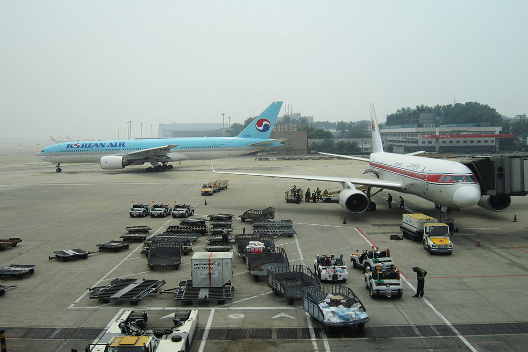 Planes at Pyongyang Airport. A North Korea plane, and a Korean Air plane