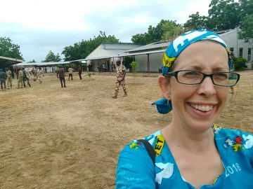 BMS pharmacist Claire Bedford at Guinebor II Hospital as soldiers walked the grounds