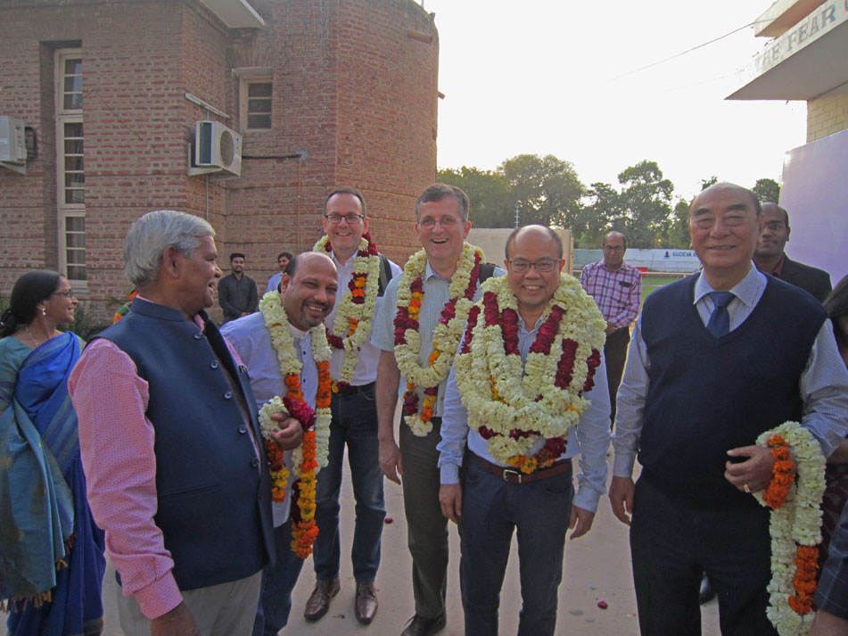 BMS workers receive a welcome marked with beautiful garlands at an event in India