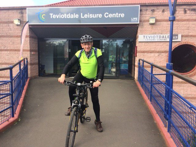 Ian Richardson on his bike outside a leisure centre