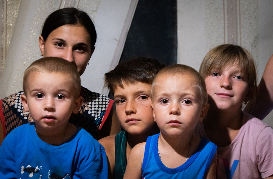 Young children in Ukraine look at the camera