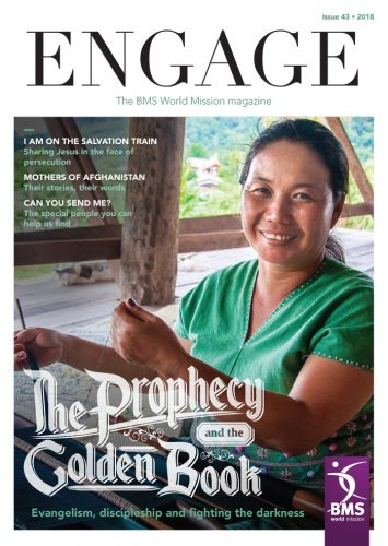 The front cover of Engage magazine features a smiling woman at a weaving loom, a sleeping cat, and the title 'The Prophecy and the Golden Book'