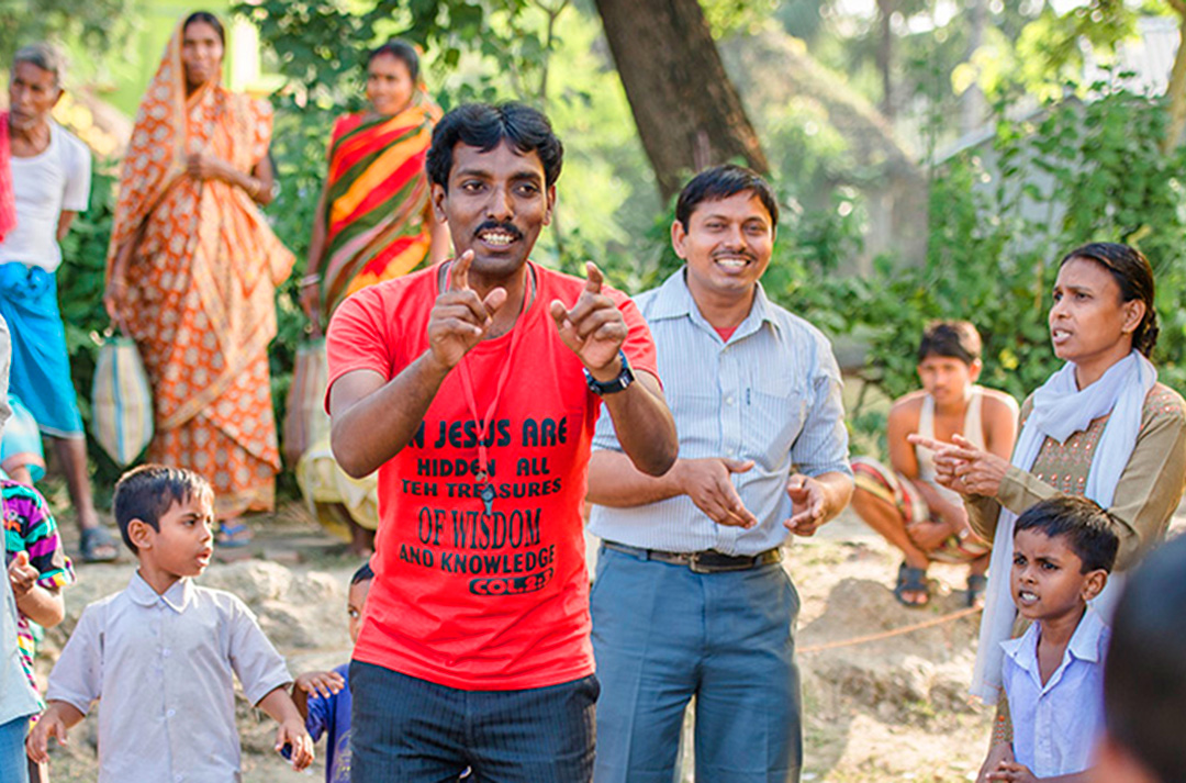 An open air teaching/worship scene in India
