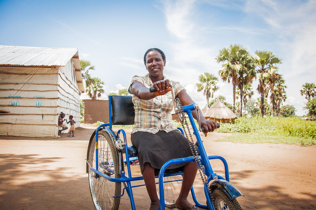 A woman sits in a wheelchair