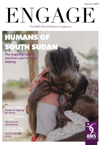 Engage cover, featuring a mother with two small children and the headline 'Humans of South Sudan'