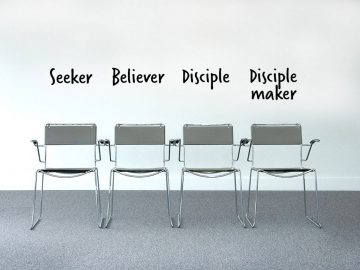 Four metal chairs stand against a white wall, with captions above them in a black font saying 'seeker', 'believer', 'disciple', 'disciple maker'.