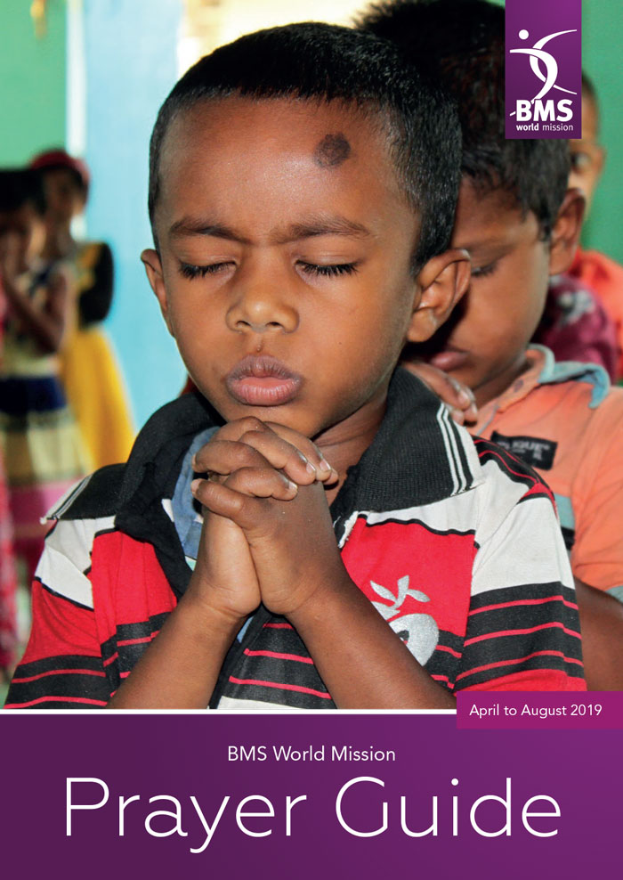 Prayer Guide cover, April to August 2019, featuring a small boy praying with deep concentration