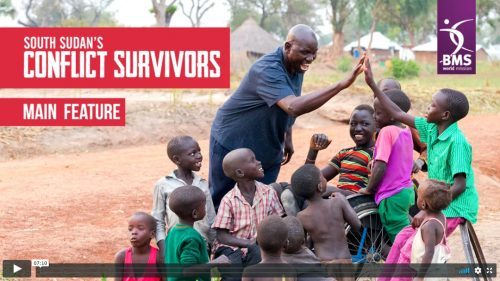 South Sudan's Conflict Survivors - screenshot of video featuring high fiving boys