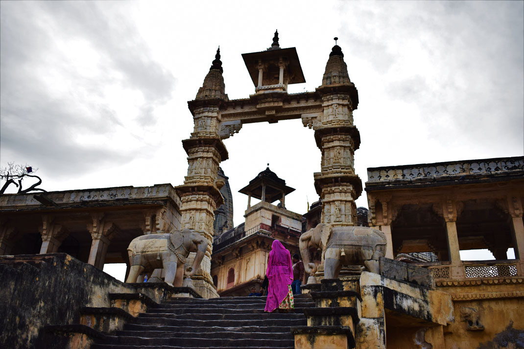 A woman in a purple sari clambers towards a Hindu temple to worship. An Action Team photo competition submission.