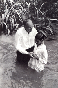Arthur Elder baptising